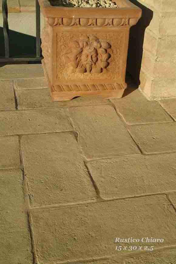 foto pavimento in cotto di forma rettangolare (15x30x2,5 cm) chiamato anche tavella